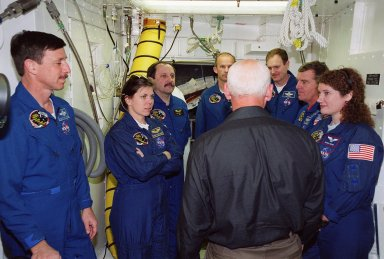 Inside the White Room at Launch Pad 39A, the STS-101 crew take part in training during a Terminal Countdown Demonstration Test (TCDT). Activities during TCDT include emergency egress from the orbiter and a dress rehearsal for launch. Standing left to right are Pilot Scott Horowitz, Mission Specialists Mary Ellen Weber, Yury Usachev and Jeffrey Williams, Commander James Halsell, and Mission Specialists James Voss and Susan Helms. During their mission to the International Space Station, the STS-101 crew will be delivering logistics and supplies, plus preparing the Station for the arrival of the Zvezda Service Module, expected to be launched by Russia in July 2000. Also, the crew will conduct one space walk to perform maintenance on the Space Station. This will be the third assembly flight for the Space Station. STS-101 is scheduled to launch April 24 at 4:15 p.m. from Launch Pad 39A