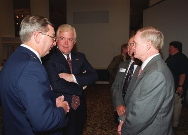 """Space Congress attendees network. From left are Brig. Gen. Donald Pettit, commander of the 45th Space Wing; Lou Dobbs, chief executive officer of Space.com; Charles Murphy, Space Congress general chairman; and Roy Bridges Jr., Kennedy Space Center director. The 37th Space Congress, sponsored by the Canaveral Council of Technical Societies, featured the theme """"Space Means Business in the 21st Century."""" The event was held at the Radisson Resort at the Port in Cape Canaveral"""