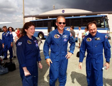 Members of the STS-101 crew gather with families and friends at Patrick Air Force Base before departure for Houston. In the foreground are Mission Specialists Susan J. Helms, Jeffrey N. Williams and Yury Usachev of Russia. At far left is Mission Specialist James S. Voss. After landing at 2:20 a.m. EDT May 29, the crew and their families enjoyed the Memorial Day holiday in Florida. The crew returned from the third flight to the International Space Station where they made repairs, transferred cargo and completed a space walk to install and connect several pieces of equipment on the outside of the Space Station