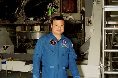 STS-92 Mission Specialist Leroy Chiao poses in front of the Integrated Truss Structure (ITS) Z1 in the Space Shuttle Processing Facility. Chiao is a member of the crew on the fifth flight to the International Space Station, scheduled for launch in mid-fall. The Z1 is an early exterior framework for the Space Station, and will allow the first U.S. solar arrays, on mission STS-97, flight 4A, to be temporarily installed on Unity for early power