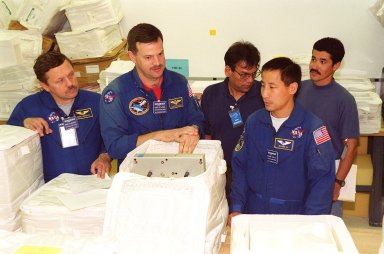 KENNEDY SPACE CENTER, FLA. -- At SPACEHAB, Port Canaveral, Fla., members of the STS-106 crew check out part of the payload, called TVIS, on their mission to the International Space Station. From left are Mission Specialist Boris Morukov, who is with the Russian Space Agency, Pilot Scott Altman and Mission Specialist Edward Lu. TVIS is the Treadmill Vibration Isolation System, a device to collect data on how vibrations imparted by crew exercise may be reduced or eliminated on the International Space Station. Those vibrations could disturb delicate microgravity experiments on the Space Station. During the mission, the crew will complete service module support tasks on orbit, transfer supplies and outfit the Space Station for the first long-duration crew. STS-106 is scheduled to launch Sept. 8