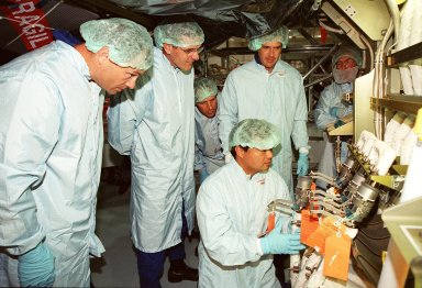 Members of the STS-92 crew check out the Integrated Truss Structure Z1, a component of the International Space Station and payload on their mission. From left are Mission Specialists Michael Lopez-Alegria, Bill McArthur, Jeff Wisoff and (kneeling) Leroy Chiao. They and other crew members are taking part in Crew Equipment Interface Test (CEIT) activities while at KSC. The Z1 truss is an early exterior framework to allow the first U.S. solar arrays on a future flight to be temporarily installed on Unity for early power. STS-92 is scheduled to launch Oct. 5 from launch Pad 39A
