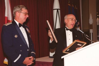 At a 50th anniversary gala capping a year-long celebration of 50 years of launches from Cape Canaveral Air Force Station, Brig. Gen. Donald Pettit (left) receives a plaque from committee chairman Ed Gormel. The first launch took place at 9:28 a.m. on July 24, 1950, with the liftoff of Bumper 8 from Launch Complex 3. The gala, hosted by the Cape Canaveral Chapter Air Force Association, featured such speakers as Center Director Roy Bridges; Vice Commander, Air Force Space Command, Lt. Gen. Roger DeKok; and the Honorable David Weldon, U.S. representative of Florida?s 15th Congressional District