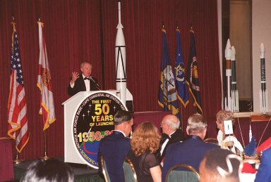 Center Director Roy Bridges addresses attendees at a 50th anniversary gala capping a year-long celebration of 50 years of launches from Cape Canaveral Air Force Station. Among those at the head table directly in front of the podium are Commander of the 45th Space Wing Brig. Gen. Donald Pettit and Gala Committee Chairman Ed Gormel. The first launch at CCAFS took place at 9:28 a.m. on July 24, 1950, with the liftoff of Bumper 8 from Launch Complex 3