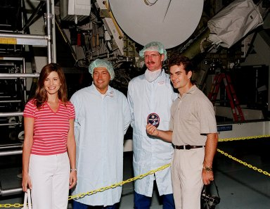 KENNEDY SPACE CENTER, FLA. -- During a visit to KSC, NASCAR race driver Jeff Gordon (far right) and his wife (far left) pose with astronauts Michael Lopez-Alegria (second from left) and Joe Tanner (third from left)