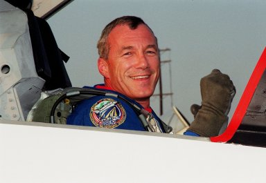 STS-106 Commander Terrence W. Wilcutt grins after landing at the KSC Shuttle Landing Facility aboard a T-38 jet aircraft. He and the rest of the crew will be taking part in Terminal Countdown Demonstration Test activities, which include emergency egress training and a simulated launch countdown. STS-106 is scheduled to launch Sept. 8, 2000, at 8:31 a.m. EDT from Launch Pad 39B. On the 11-day mission, the seven-member crew will perform support tasks on orbit, transfer supplies and prepare the living quarters in the newly arrived Zvezda Service Module. The first long-duration crew, dubbed ?Expedition One,? is due to arrive at the Station in late fall