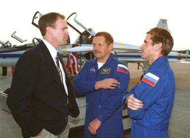 Jim Halsell Jr. (left), former mission commander and now the manager, Shuttle Program Integration Office, chats with STS-106 Mission Specialists Boris V. Morukov (center) and Yuri I. Malenchenko (right) after their arrival at KSC. Morukov and Malenchenko, who are with the Russian Aviation and Space Agency, are at KSC with the rest of the crew to take part in Terminal Countdown Demonstration Test activities, which include emergency egress training and a simulated launch countdown. STS-106 is scheduled to launch Sept. 8, 2000, at 8:31 a.m. EDT from Launch Pad 39B. On the 11-day mission, the seven-member crew will perform support tasks on orbit, transfer supplies and prepare the living quarters in the newly arrived Zvezda Service Module. The first long-duration crew, dubbed ?Expedition One,? is due to arrive at the Station in late fall