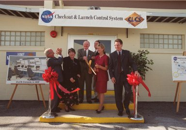 The ribbon is cut and the new Checkout and Launch Control System (CLCS) declared operational. Those taking part in the ceremony are (from left) Joseph Rothenberg, NASA Associate Administrator for Space Flight; Pam Gillespie, from Rep. Dave Weldon's office; Roy Bridges, Kennedy Space Center director; Dave King, director of Shuttle Processing; Retha Hart, deputy associate director, Spaceport Technology Management Office; and Ron Dittemore, manager, Space Shuttle Program. The new control room will be used to process the Orbital Maneuvering System pods and Forward Reaction Control System modules at the HMF. This hardware is removed from Space Shuttle orbiters and routinely taken to the HMF for checkout and servicing