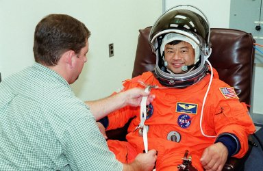In the Operations and Checkout Building, STS-92 Mission Specialist Leroy Chiao has his launch and entry suit adjusted during fit check. Chiao and the rest of the crew are at KSC for Terminal Countdown Demonstration Test activities. The TCDT provides emergency egress training, simulated countdown exercises and opportunities to inspect the mission payload. This mission will be Chiao?s third Shuttle flight. STS-92 is scheduled to launch Oct. 5 at 9:38 p.m. EDT from Launch Pad 39A on the fifth flight to the International Space Station. It will carry two elements of the Space Station, the Integrated Truss Structure Z1 and the third Pressurized Mating Adapter. The mission is also the 100th flight in the Shuttle program
