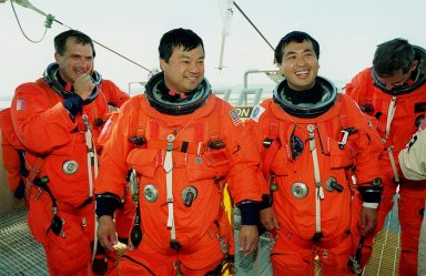 KENNEDY SPACE CENTER, FLA. -- STS-92 Mission Specialists (left to right) Peter J.K. ?Jeff? Wisoff, Leroy Chiao, Koichi Wakata of Japan and William S. McArthur Jr. finish emergency egress training in the slidewire baskets behind them. The training is part of Terminal Countdown Demonstration Test activities that also include a simulated countdown. STS-92 is scheduled to launch Oct. 5 at 9:38 p.m. EDT on the fifth flight to the International Space Station. It will carry two elements of the Space Station, the Integrated Truss Structure Z1 and the third Pressurized Mating Adapter. The mission is also the 100th flight in the Shuttle program