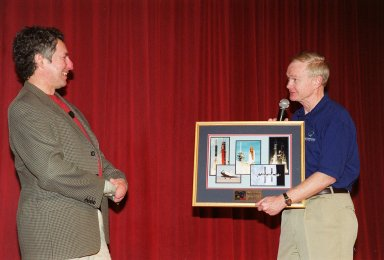 During Super Safety and Health Day at KSC, keynote speaker Dr. Beck Weathers is given a memento of his visit by Center Director Roy Bridges. Weathers spoke about his ordeal of surviving the 1996 Mt. Everest disaster and the lessons learned from the experience. Safety Day is a full day of NASA-sponsored, KSC and 45th Space Wing events involving a number of health and safety related activities: Displays, vendors, technical paper sessions, panel discussions, a keynote speaker, etc. The entire Center and Wing stand down to participate in the planned events. Safety Day is held annually to proactively increase awareness in safety and health among the government and contractor workforce population. The first guiding principle at KSC is ?Safety and Health First.? KSC?s number one goal is to ?Assure sound, safe and efficient practices and processes are in place for privatized/commercialized launch site processing.