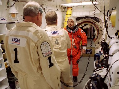 STS-92 Mission Specialist Koichi Wakata of Japan gets a final check of his launch and entry suit in the White Room before entering Discovery. The White Room is an environmentally controlled area at the end of the Orbiter Access Arm that provides entry to the orbiter as well as emergency egress if needed. The arm remains in the extended position until 7 minutes 24 seconds before launch. Wakata and the rest of the crew are making the fifth flight to the International Space Station for construction. Discovery carries a payload that includes the Integrated Truss Structure Z-1, first of 10 trusses that will form the backbone of the Space Station, and the third Pressurized Mating Adapter that will provide a Shuttle docking port for solar array installation on the sixth Station flight and Lab installation on the seventh Station flight. The mission includes four spacewalks for the construction activities. Discovery?s landing is expected Oct. 22 at 2:10 p.m. EDT