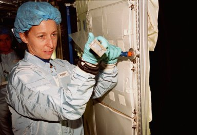 In the Space Station Processing Facility, STS-98 Mission Specialist Marsha Ivins wields a tool on part of the U.S. Lab, Destiny. The crew is checking out equipment inside the lab as part of Crew Equipment Interface Test activities, becoming familiar with equipment it will be handling during the mission. Others in the crew are Commander Ken Cockrell, Pilot Mark Polansky and Mission Specialists Robert Curbeam and Thomas Jones. The mission will be transporting the Lab to the International Space Station with five system racks already installed inside of the module. With delivery of electronics in the lab, electrically powered attitude control for Control Moment Gyroscopes will be activated. The STS-98 launch is scheduled for Jan. 18, 2001