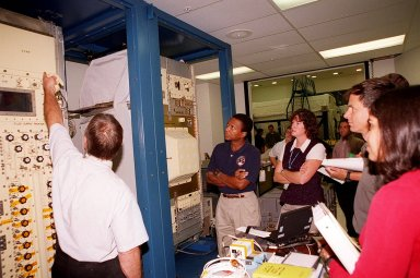 KENNEDY SPACE CENTER, FLA. -- Members of the STS-107 crew check out equipment at SPACEHAB. Beginning in the center are Mission Specialists Michael Anderson and Laurel Clark; at far right are Ilan Ramon, from Israel, and Kalpana Chawla. Identified as a research mission, STS-107 is scheduled for launch July 19, 2001