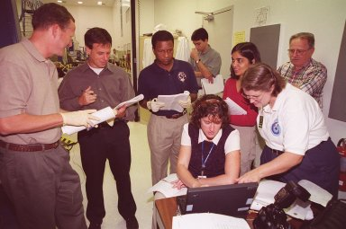KENNEDY SPACE CENTER, FLA. -- At SPACEHAB, STS-107 crew members become acquainted with equipment that will be on the mission. From left are Mission Specialists David Brown, Ilan Ramon (from Israel), Michael Anderson and Kalpana Chawla; seated in front is Mission Specialist Laurel Clark. Identified as a research mission, STS-107 is scheduled for launch July 19, 2001