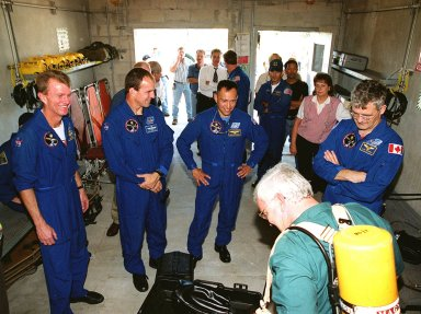 Inside the bunker at Launch Pad 39B, a trainer explains the use of an air pack to some of the STS-97 crew. At left is Commander Brent Jett; then Pilot Mike Bloomfield and Mission Specialists Carlos Noriega and Marc Garneau (far right). The training is part of Terminal Countdown Demonstration Test (TCDT) activities, which also include a simulated launch countdown and opportunities for the crew to inspect the mission payloads in the orbiter?s payload bay. Mission STS-97is the sixth construction flight to the International Space Station. Its payload includes the P6 Integrated Truss Structure and a photovoltaic (PV) module, with giant solar arrays that will provide power to the Station. The mission includes two spacewalks to complete the solar array connections. STS-97 is scheduled to launch Nov. 30 at 10:05 p.m. EST