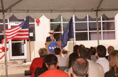 Center Director Roy Bridges welcomes the audience to a ribbon-cutting ceremony at the E&O Building at KSC. Home for NASA?s unmanned missions since 1964, the building has been renovated to house the Expendable Launch Vehicle Program