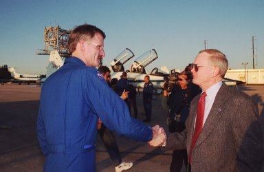 At the Shuttle Landing Facility, STS-97 Mission Specialist Joseph Tanner (left) is greeted by Center Director Roy Bridges on his arrival at KSC from Johnson Space Center. Tanner and the rest of the crew have returned to KSC for the launch, scheduled for Nov. 30 at about 10:06 p.m. EST. Mission STS-97is the sixth construction flight to the International Space Station. Its payload includes the P6 Integrated Truss Structure and a photovoltaic (PV) module, with giant solar arrays that will provide power to the Station. The mission includes two spacewalks to complete the solar array connections. STS-97 is scheduled to launch Nov. 30 at about 10:06 p.m. EST