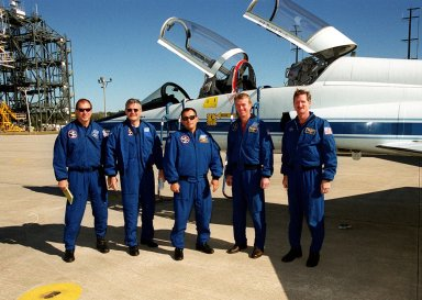 The STS-97 crew poses for a photo at the Shuttle Landing Facility after their arrival. Standing left to right are Pilot Michael Bloomfield, Mission Specialists Marc Garneau and Carlos Noriega, Commander Brent Jett and Mission Specialist Joseph Tanner. They are at KSC for a final payload walkdown before launch, scheduled for Nov. 30 at 10:06 p.m. EST from Launch Pad 39B. The sixth flight to the International Space Station, the mission is expected to last 11 days, with a planned KSC landing at about 5:58 p.m. Dec. 11