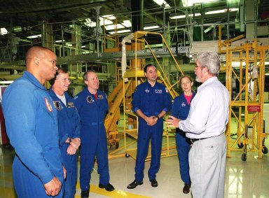 KENNEDY SPACE CENTER, FLA. -- In Orbiter Processing Facility bay 3, the STS-98 crew talks with United Space Alliance worker Larry Oshein (right). Standing left to right are Mission Specialist Robert Curbeam, Commander Ken Cockrell, Mission Specialist Tom Jones, and Mission Specialists Mark Polansky and Marsha Ivins. The crew is at KSC for Crew Equipment Interface Test activities. Launch on mission STS-98 is scheduled for Jan. 18, 2001. It will be transporting the U.S. Lab, Destiny, to the International Space Station with five system racks already installed inside of the module. After delivery of electronics in the lab, electrically powered attitude control for Control Moment Gyroscopes will be activated