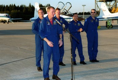 After arriving at the Shuttle Landing Facility, the STS-97 crew gather to address the media. At the microphone, Commander Brent Jett praises the efforts of the KSC workers to get ready for the launch. Behind Jett are Pilot Michael Bloomfield and Mission Specialists Joseph Tanner, Carlos Noriega and Marc Garneau, who is with the Canadian Space Agency. Mission STS-97 is the sixth construction flight to the International Space Station. Its payload includes the P6 Integrated Truss Structure and a photovoltaic (PV) module, with giant solar arrays that will provide power to the Station. The mission includes two spacewalks to complete the solar array connections. STS-97 is scheduled to launch Nov. 30 at about 10:06 p.m. EST