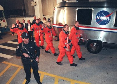 Leaving the Operations and Checkout Building, the STS-97 crew hurries toward the waiting Astrovan that will take them to Launch Pad 39B. Starting at left, they are Mission Specialists Carlos Noriega, Joseph Tanner and Marc Garneau; Pilot Michael Bloomfield; and Commander Brent Jett. Garneau is with the Canadian Space Agency. Mission STS-97 is the sixth construction flight to the International Space Station. It is transporting the P6 Integrated Truss Structure that comprises Solar Array Wing-3 and the Integrated Electronic Assembly, to be installed on the Space Station. The solar arrays are mounted on a ?blanket? that can be folded like an accordion for delivery. Once in orbit, astronauts will deploy the blankets to their full size. The 11-day mission includes two spacewalks to complete the solar array connections. The Station?s electrical power system will use eight photovoltaic solar arrays, each 112 feet long by 39 feet wide, to convert sunlight to electricity. Gimbals will be used to rotate the arrays so that they will face the Sun to provide maximum power to the Space Station. Launch is scheduled for Nov. 30 at 10:06 p.m. EST