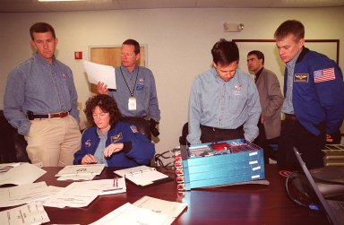 KENNEDY SPACE CENTER, FLA. -- Members of the STS-107 crew take part in In-Flight Maintenance training for their mission. Looking over an OSTEO experiment and paperwork are (left to right) Commander Rick D. Husband; Mission Specialists Laurel Clark, David M. Brown and Ilan Ramon of Israel; and Pilot William C. ?Willie? McCool. As a research mission, STS-107will carry the SPACEHAB Double Module in its first research flight into space and a broad collection of experiments ranging from material science to life science. It is scheduled to launch July 19, 2001