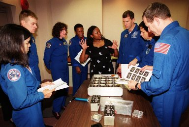 KENNEDY SPACE CENTER, FLA. -- As part of In-Flight Maintenance training at SPACEHAB, in Cape Canaveral, Fla., members of the STS-107 crew learn about Biological Research in Canisters (BRIC) experiments that will be on their mission. From left are Mission Specialist Kalpana Chawla, Pilot William C. ?Willie? McCool, Mission Specialists Laurel Clark and Michael Anderson, Roberteen McCray of Bionetics, Commander Rick D. Husband,; Payload Specialist Ilan Ramon of Israel and Mission Specialist David M. Brown. STS-107 will carry a broad collection of experiments ranging from material science to life science. It is scheduled to launch July 19, 2001