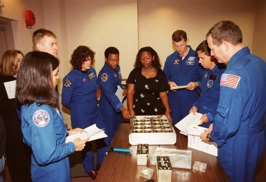 As part of In-Flight Maintenance training at SPACEHAB, in Cape Canaveral, Fla., members of the STS-107 crew learn about Biological Research in Canisters (BRIC) experiments that will be on their mission. Gathered around the table are (from left) Mission Specialist Kalpana Chawla, Pilot William C. ?Willie? McCool, Mission Specialists Laurel Clark and Michael Anderson, Roberteen McCray of Bionetics, Commander Rick D. Husband, Payload Specialist Ilan Ramon of Israel and Mission Specialist David M. Brown. STS-107 will carry a broad collection of experiments ranging from material science to life science. It is scheduled to launch July 19, 2001