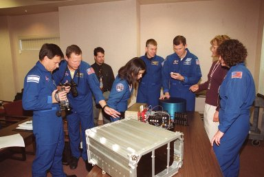 KENNEDY SPACE CENTER, FLA. -- As part of In-Flight Maintenance training, members of the STS-107 crew check out one of the Biotube experiments that will be part of their research mission. From left (in uniform) are Payload Specialist Ilan Ramon of Israel, Mission Specialists David M. Brown and Kalpana Chawla, Pilot William C. ?Willie? McCool (crouching behind the table), Commander Rick D. Husband, and Mission Specialist Laurel Clark. STS-107 will carry the SPACEHAB Double Module in its first research flight into space and a broad collection of experiments ranging from material science to life science. It is scheduled to launch July 19, 2001