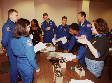KENNEDY SPACE CENTER, FLA. -- As part of In-Flight Maintenance training at SPACEHAB, in Cape Canaveral, Fla., the STS-107 crew learns about Biological Research in Canisters (BRIC) experiments that will be on their mission. From left are Mission Specialist Kalpana Chawla, Pilot William C. ?Willie? McCool, Roberteen McCray of Bionetics, Commander Rick D. Husband, Payload Specialist Ilan Ramon of Israel, and Mission Specialists David M. Brown and Michael Anderson. At right is Debbie Wells of Bionetics. Not seen is Mission Specialist Laurel Clark. STS-107 will carry a broad collection of experiments ranging from material science to life science. It is scheduled to launch July 19, 2001