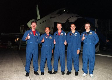 KENNEDY SPACE CENTER, FLA. -- The STS-97 crew pauses for a photograph before heading for crew quarters. They landed safely at the SLF at 6:04 p.m. EST after a successful mission. From the left are Mission Specialists Joseph Tanner and Carlos Noriega, Commander Brent Jett, Pilot Michael Bloomfield and Mission Specialist Marc Garneau of Canada. Endeavour carried the P6 Integrated Truss Structure with solar arrays to power the International Space Station. The arrays and other equipment were installed during three EVAs that totaled 19 hours, 20 minutes. Endeavour was docked with the Space Station for 6 days, 23 hours, 13 minutes. This was the 16th nighttime landing for a Space Shuttle and the 53rd at Kennedy Space Center