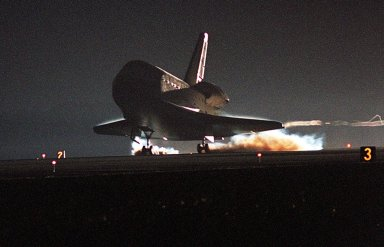 KENNEDY SPACE CENTER, Fla. -- Kicking up dust, Endeavour?s main gear touches down on Runway 15 at the Shuttle Landing Facility at 6:03 p.m. EST. At the controls is Commander Brent Jett, completing the successful 10-day, 19-hour and 58-minute-long STS-97 mission. Other crew members on board are Pilot Michael Bloomfield and Mission Specialists Joseph Tanner, Carlos Noriega and Marc Garneau, with the Canadian Space Agency. On the 4.4-million-mile mission, Endeavour carried the P6 Integrated Truss Structure with solar arrays to power the International Space Station. The arrays and other equipment were installed during three EVAs that totaled 19 hours, 20 minutes. Endeavour was docked with the Space Station for 6 days, 23 hours, 13 minutes. This is the 16th nighttime landing for a Space Shuttle and the 53rd at Kennedy Space Center
