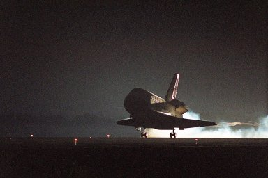 KENNEDY SPACE CENTER, Fla. -- In the waning light after sunset, Endeavour?s main gear touches down on Runway 15 at the Shuttle Landing Facility at 6:03 p.m. EST. At the controls is Commander Brent Jett, completing the successful 10-day, 19-hour and 58-minute-long STS-97 mission. Other crew members on board are Pilot Michael Bloomfield and Mission Specialists Joseph Tanner, Carlos Noriega and Marc Garneau of Canada. On the 4.4-million-mile mission, Endeavour carried the P6 Integrated Truss Structure with solar arrays to power the International Space Station. The arrays and other equipment were installed during three EVAs that totaled 19 hours, 20 minutes. Endeavour was docked with the Space Station for 6 days, 23 hours, 13 minutes. This is the 16th nighttime landing for a Space Shuttle and the 53rd at Kennedy Space Center