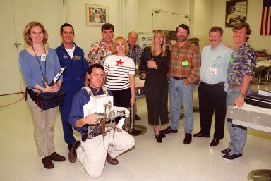 The crew of the television series This Old House pauses for a photo during a tour of KSC. At the far right is Steve Thomas, host of the series. Second from the right is Norm Abram, master carpenter on the show. Accompanying the film crew is astronaut John Herrington (second from left). The cast and crew of This Old House are filming at KSC for an episode of the show