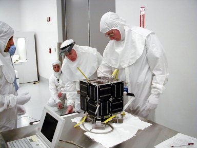 KODIAK ISLAND, Alaska -- Technicians prepare the PICSat payload for its launch aboard the Athena 1 launch vehicle at Kodiak Island, Alaska, as preparations to launch Kodiak Star proceed. The first orbital launch to take place from Alaska's Kodiak Launch Complex, Kodiak Star is scheduled to lift off on a Lockheed Martin Athena I launch vehicle on Sept. 17 during a two-hour window that extends from 5 p.m. to 7 p.m. p.m. ADT. The payloads aboard include the Starshine 3, sponsored by NASA, and the PICOSat, PCSat and Sapphire, sponsored by the Department of Defense (DoD) Space Test Program.