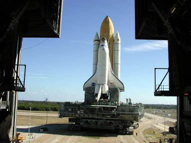 KENNEDY SPACE CENTER, Fla. -- Space Shuttle Atlantis, on its Mobile Launcher Platform, rolls out to Launch Pad 39A for the second time. An attempt to roll out on Jan. 2 incurred a failed computer processor on the first crawler transporter. The Shuttle was returned to the VAB using a secondary computer processor on the vehicle. Atlantis will fly on mission STS-98, the seventh construction flight to the International Space Station, carrying the U.S. Laboratory, named Destiny. The lab module will have five system racks already installed inside. After delivery of electronics in the lab, electrically powered attitude control for Control Moment Gyroscopes will be activated. Atlantis is scheduled for launch no earlier than Jan. 19, 2001, with a crew of five