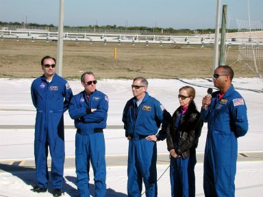 KENNEDY SPACE CENTER, Fla. -- In the slidewire basket landing zone at Launch Pad 39A, the STS-98 crew gathers for a media briefing. With the microphone is Mission Specialist Robert Curbeam, who is talking about some of his activities during the mission. The others are (left to right) Pilot Mark Polansky, Mission Specialist Thomas Jones, Commander Ken Cockrell and Mission Specialist Marsha Ivins. The landing zone provides an escape route for personnel aboard the Space Shuttle and orbiter access arm until 30 seconds before launch. They are at KSC to take part in Terminal Countdown Demonstration Test activities, which also include a simulated launch countdown. STS-98 is the seventh construction flight to the International Space Station, carrying as payload the U.S. Lab Destiny, a key element in the construction of the ISS. Launch of STS-98 is scheduled for Jan. 19 at 2:11 a.m