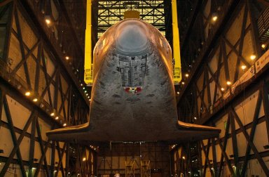 The underside of orbiter Discovery is seen as it is lifted to vertical in the transfer aisle of the Vehicle Assembly Building. It will then be lifted up and into high bay 1 for mating with its solid rocket boosters and external tank. Discovery will be launched March 8 on mission STS-102, the eighth construction flight to the International Space Station. The Shuttle will carry the Multi-Purpose Logistics Module Leonardo, the first of three pressurized modules provided by the Italian Space Agency to carry supplies and equipment to the Space Station and back to earth