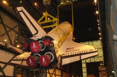 In the transfer aisle of the Vehicle Assembly Building, the orbiter Discovery is lifted for mating. It will be moved into high bay 1 and mated with its solid rocket boosters and external tank. Discovery will be launched March 8 on mission STS-102, the eighth construction flight to the International Space Station. The Shuttle will carry the Multi-Purpose Logistics Module Leonardo, the first of three pressurized modules provided by the Italian Space Agency to carry supplies and equipment to the Space Station and back to earth
