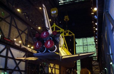 In the transfer aisle of the Vehicle Assembly Building, the orbiter Discovery (seen from the back) is lifted to vertical. It will then be lifted up and into high bay 1 for mating with its solid rocket boosters and external tank. Discovery will be launched March 8 on mission STS-102, the eighth construction flight to the International Space Station. The Shuttle will carry the Multi-Purpose Logistics Module Leonardo, the first of three pressurized modules provided by the Italian Space Agency to carry supplies and equipment to the Space Station and back to earth