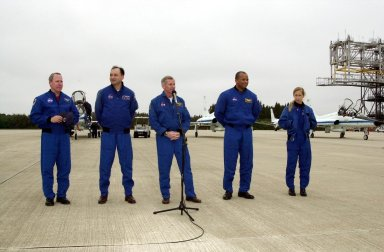KENNEDY SPACE CENTER, FLA. -- STS-98 Mission Commander Kenneth Cockrell (center at microphone) speaks to the media at the Shuttle Landing Facility after the crew's arrival Sunday to complete preparations for launch.; The crew also includes, from left to right, Mission Specialist Thomas Jones, Pilot Mark Polansky and Mission Specialists Robert Curbeam and Marsha Ivins. STS-98 is the seventh construction flight to the International Space Station, carrying as payload the U.S. Lab Destiny, a key element in the construction of the ISS. Launch of STS-98 is scheduled for Feb. 7 at 6:11 p.m. EST