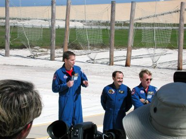 KENNEDY SPACE CENTER, Fla. -- At the slidewire basket landing near Launch Pad 39B, the media interview the STS-102 crew. With the microphone is Commander James Wetherbee. Next to him is Yury Usachev, one of the Expedition Two crew who will be on the flight, and Mission Specialist Andrew Thomas. The STS-102 crew is at KSC to take part in Terminal Countdown Demonstration Test activities, which also include a simulated launch countdown. STS-102 is the eighth construction flight to the International Space Station, with Space Shuttle Discovery carrying the Multi-Purpose Logistics Module Leonardo. In addition, the Expedition Two crew will be replacing Expedition One, who will return to Earth with Discovery. Launch on mission STS-102 is scheduled for March 8