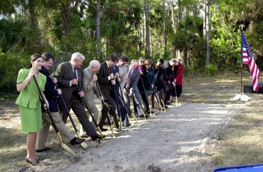 At a groundbreaking ceremony, participants and guests get ready to dig in, signifying the start of construction on a new roadway through KSC. It is the start of a construction project that includes the Space Experiment Research & Processing Laboratory (SERPL). From left are Dr. Pamella J. Dana, from the executive office of Florida?s governor, Jeb Bush; Deputy Associate Administrator Michael Hawes, Space Station, NASA; Sen. George Kirkpatrick; Spaceport Florida Authority Executive Director Ed Gormel; Executive Director Dr. Samuel T. Durrance, Florida Space Research Institute; Florida?s Lt. Gov. Frank Brogan; Congressman Dave Weldon; Center Director Roy Bridges Jr.; SFA SERPL Program Manager Debra Holliday; KSC SERPL Program Manager Jan Heuser; District Manager Cheryl Harrison-Lee, Florida Department of Transportation; State Senator Jim Sebesta; and KSC Director JoAnn H. Morgan, External Relations and Business Development. The project is enabled by a partnership and collaboration between NASA and the State of Florida to create a vital resource for international and commercial space customers. SERPL is considered a magnet facility, and will support the development and processing of life sciences experiments destined for the International Space Station and accommodate NASA, industry and academic researchers performing associated biological research