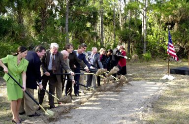 At a groundbreaking ceremony, participants and guests toss their shovelfuls of dirt, signifying the start of construction on a new roadway through KSC. From left are Dr. Pamella J. Dana, from the executive office of Florida?s governor, Jeb Bush; Deputy Associate Administrator Michael Hawes, NASA; Sen. George Kirkpatrick; Spaceport Florida Authority Executive Director Ed Gormel; Executive Director Dr. Samuel T. Durrance, Florida Space Research Institute; Florida?s Lt. Gov. Frank Brogan; Congressman Dave Weldon; Center Director Roy Bridges Jr.; SFA SERPL Program Manager Debra Holliday; KSC SERPL Program Manager Jan Heuser; District Manager Cheryl Harrison-Lee, Florida Department of Transportation; State Senator Jim Sebesta; and KSC Director JoAnn H. Morgan, External Relations and Business Development The roadway, to be known as Space Commerce Way, will serve the public by providing a 24-hour access route through KSC from S.R. 3 to the NASA Causeway and KSC Visitor Complex. It is the start of a construction project that includes the Space Experiment Research & Processing Laboratory (SERPL). Considered a magnet facility, the laboratory will support the development and processing of life sciences experiments destined for the International Space Station and accommodate NASA, industry and academic researchers performing associated biological research.. The project is enabled by a partnership and collaboration between NASA and the State of Florida to create a vital resource for international and commercial space customers