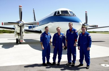 From the Cape Canaveral Air Force Station Skid Strip, the STS-102 crew prepares to depart for the Johnson Space Center in Houston. Standing, left to right, are Mission Specialists Paul Richards and Andrew Thomas, Commander James Wetherbee and Pilot James Kelly. The crew returned to Earth aboard Discovery March 21, concluding mission STS-102 to the International Space Station