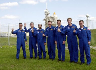 KENNEDY SPACE CENTER, FLA. -- The STS-100 crew gives thumbs up on launch as they gather near Launch Pad 39A to greet family and friends. Starting at left, they are Mission Specialists Chris A. Hadfield, John L. Phillips and Umberto Guidoni; Commander Kent V. Rominger; Pilot Jeffrey S. Ashby; and Mission Specialists Scott E. Parazynski and Yuri V. Lonchakov. Hadfield is with the Canadian Space Agency; Guidoni is with the European Space Agency; and Lonchakov is with the Russian Aviation and Space Agency. In the background on the pad can be seen the tips of Space Shuttle Endeavour?s orange external tank and white solid rocket boosters. The 80-foot lightning rod towers above the Shuttle and service structures. The crew is at KSC to complete final flight plan reviews in anticipation of launch. The 11-day mission to the International Space Station will deliver and integrate the Spacelab Logistics Pallet/Launch Deployment Assembly, which includes the Space Station Remote Manipulator system and the UHF Antenna, and the Multi-Purpose Logistics Module Raffaello. The mission includes two planned spacewalks for installation of the SSRMS. The mission is also the inaugural flight of the MPLM Raffaello, carrying resupply stowage racks and resupply/return stowage platforms. Liftoff on mission STS-100 is scheduled at 2:41 p.m. EDT April 19