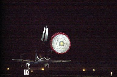 KENNEDY SPACE CENTER, Fla. -- With the drag chute slowing its speed, Atlantis prepares to land on Runway 15 at the Shuttle Landing Facility to complete a 12-day, 18-hour, 34-minute-long STS-104 mission. Main gear touchdown occurred at 11:38:55 p.m. EDT. At the controls is Commander Steven W. Lindsey. Other crew members on board are Pilot Charles Hobaugh and Mission Specialists Michael Gernhardt, Janet Lynn Kavandi and James F. Reilly. This is the 18th nighttime landing for a Space Shuttle, the 13th at Kennedy Space Center. The mission delivered the Joint Airlock Module to the International Space Station, completing the second phase of the assembly of the Space Station