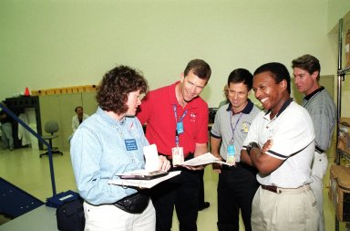 KENNEDY SPACE CENTER, Fla. -- At SPACEHAB, Cape Canaveral, Fla., the STS-107 crew takes part in Crew Equipment Interface Test (CEIT) activities. From left are Mission Specialist Laurel Blair Salton Clark, Commander Rick Douglas Husband, Payload Specialist Ilan Ramon, of Israel, and Payload Commander Michael P. Anderson. A trainer is at far right. As a research mission, STS-107 will carry the Spacehab Double Module in its first research flight into space and a broad collection of experiments ranging from material science to life science. The CEIT activities enable the crew to perform certain flight operations, operate experiments in a flight-like environment, evaluate stowage locations and obtain additional exposure to specific experiment operations. Other STS-107 crew members are Pilot William C. McCool and Mission Specialists Kalpana Chawla and David M. Brown. STS-107 is scheduled for launch May 23, 2002