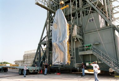 KENNEDY SPACE CENTER, Fla. -- At Launch Complex 17-A, Cape Canaveral Air Force Station, the second part of the fairing for the Genesis spacecraft is lifted up the gantry. The fairing will encapsulate the spacecraft to protect it during launch aboard a Delta II rocket. Genesis will be on a journey to capture samples of the ions and elements in the solar wind and return them to Earth for scientists to use to determine the exact composition of the Sun and the solar system?s origin. NASA?s Genesis project in managed by the Jet Propulsion Laboratory in Pasadena, Calif. Lockheed Martin Astronautics built the Genesis spacecraft for NASA in Denver, Colo. The launch is scheduled for July 30 at 12:36 p.m. EDT